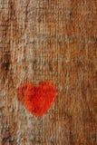 Hjärta målade på en träyttersida, trätextur Royaltyfri Fotografi