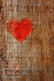 Hjärta målade på en träyttersida, trätextur Arkivfoto