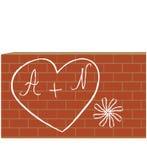 Hjärta med bokstäver på tegelstenväggen Arkivbilder