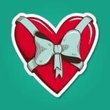 Hjärta med bowen Arkivbild