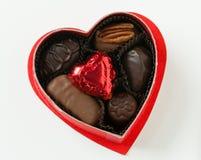 Hjärta med chokladgodisen Fotografering för Bildbyråer