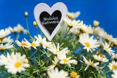 Hjärta med Margeriten, text, Royaltyfria Bilder