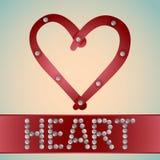 Hjärta med metallbultar Arkivfoto
