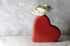 Hjärta och blomma Arkivfoto