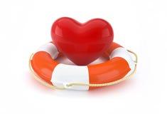 Hjärta och livboj med livbesparingbegrepp Arkivfoto