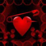 Hjärta och säkerhetsnål Arkivfoton