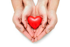 Hjärta på de mänskliga händerna Arkivbilder