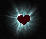 Hjärta på en svart bakgrund Arkivfoto