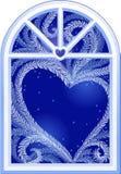 Hjärta på fönster Arkivbilder