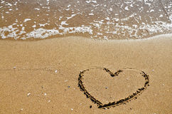 Hjärta på sanden Arkivbild