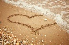 Hjärta på sanden Royaltyfria Bilder