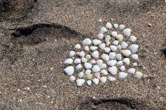 Hjärta på stranden Arkivfoto