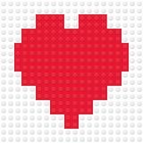 Hjärta Shape som skapas från byggnadsleksaktegelstenar Arkivfoto