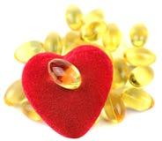 Hjärta som fylls med omega 3 royaltyfri foto
