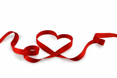Hjärta som göras av en pappersexercis Arkivfoto