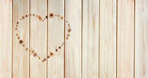 Hjärta som göras av fnurror på stiga ombord arkivbild