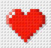 Hjärta som göras från plast- konstruktionskvarter Royaltyfria Bilder