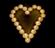 Hjärta som göras med stearinljus Arkivfoto