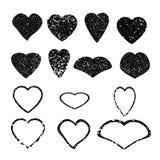Hjärta Uppsättning av svarta grungehjärtor Arkivbilder