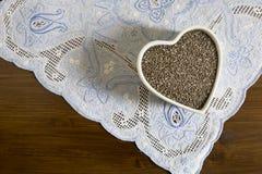 Hjärtabehållare av Chia Seeds Fotografering för Bildbyråer