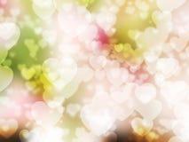 Hjärtabokeh på älskvärda rosa färger gör grön vit bakgrund arkivfoton