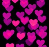 Hjärtabokehbakgrund, oskarpa objekt för foto, rosa färger på svart Arkivfoto