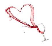 Hjärtafärgstänk från ett exponeringsglas av rött vin Royaltyfri Fotografi