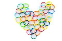 Hjärtaform av färgrika hårmusikband Arkivfoto
