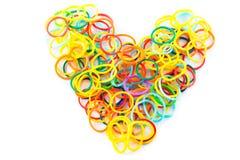 Hjärtaform av färgrika hårmusikband Arkivbild