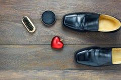Hjärtaform för den bästa sikten med skon för skor och för tillbehör för man` s att bry sig Arkivfoton