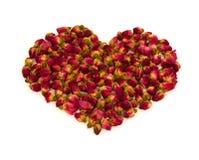 Hjärtaform som göras av rosebuds royaltyfria foton