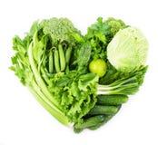 Hjärtaformform vid grönsaker royaltyfria bilder