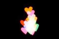 Hjärtaformljus för suddighetsbakgrund Royaltyfri Bild