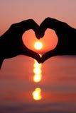 hjärtaformsolnedgång fotografering för bildbyråer