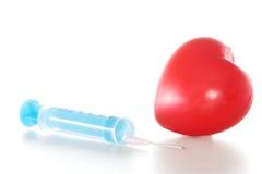 hjärtainjektionsspruta Arkivfoto