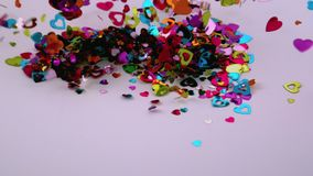 Hjärtakonfetti blåser bort arkivfilmer