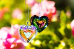 Hjärtakristallexponeringsglas bryter solljus - exponeringsglas för kristall för solljusklockabackgroundheart bryta solljus - rost arkivfoton
