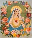 Hjärtan av jungfruliga Mary i blommorna Den typiska katolska bilden skrivev ut i Tyskland från slutet av 19 cent Royaltyfri Fotografi