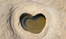 Hjärtapudding Handfathjärta som orsakas av erosion av de starka bubbelpoolerna arkivbilder