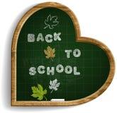 HjärtaShape svart tavla med uttryck tillbaka till skolan Royaltyfria Foton