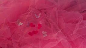 Hjärtor aspirerar på en röd bakgrund Begrepp av förälskelse, St Valentin Royaltyfri Bild