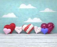 Hjärtor för dag sju för valentin` s skinande på målad himmelbakgrund Royaltyfri Foto