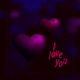 Hjärtor med en blom- modell på en mörk purpurfärgad oskarp bakgrund Fotografering för Bildbyråer