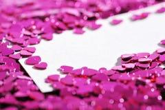 Hjärtor med kortet Fotografering för Bildbyråer