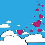 Hjärtor med vingar flyger i den blåa himlen nära fördunklar Royaltyfria Bilder