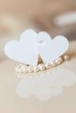 Hjärtor och pärlor royaltyfri foto