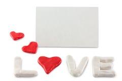 Hjärtor och pilbåge på en vitbakgrund arkivfoto