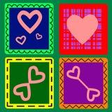 4 hjärtor på en vykort till valentin dag Arkivfoton