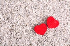 Hjärtor på sand royaltyfri foto