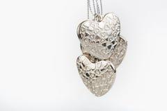 hjärtor silver tre Arkivbild
